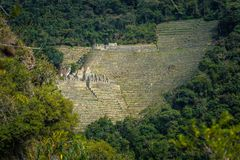 Inca Trail, Peru - August 03, 2017: Panoramic view of the Ancient ruins of Winay Wayna, on the Inca Trail, Peru. Inca Trail, Peru - August 03, 2017: The royalty free stock images