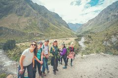 Inca Trail, Peru: August 11th, 2018:A group of hikers are taking photos on the famous Inca Trail. They will need to walk 4 days to stock image