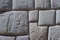 Inca wall background in Cusco, Peru. Inca wall made of natural volcanic stones, perfectly shaped, heritage of Inca history and architecture in Cusco, Peru Stock Photo