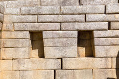 Inca Wall in Machu Picchu, Peru, South America. Example of polygonal masonry. Royalty Free Stock Photos