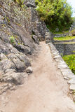 Inca Wall in Machu Picchu, Peru, South America. Example of polygonal masonry. The famous 32 angles stone Royalty Free Stock Image