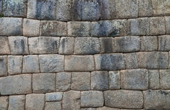 Inca wall in the village Machu-Picchu, Peru, South America royalty free stock photography