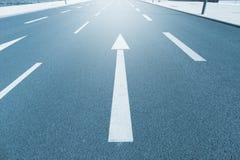 Incalculable way. Arrow on asphalt Stock Photography
