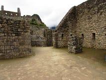 Incan walls at Machu Picchu Peru. Incan walls on site at Machu Picchu Peru Royalty Free Stock Images