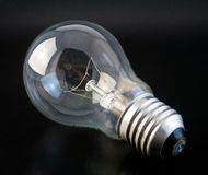Incandescence lamp 1. Incandescence lamp on black ground Royalty Free Stock Photography