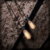 Incandescence lamp on brick grunge ceiling. Incandescence lamp on brick grunge ceiling taken closeup Stock Image