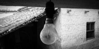 A INCANDESCENT BULB. Its a picture of a bulb that brightens the black and white lives of the  in my village royalty free stock photography