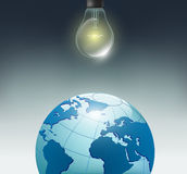 Incandescent bulb and planet earth Stock Photography