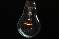 Incandescent bulb. An incandescent bulb of the push and twist type. This type of bulb is getting obsolete and usage is minimal now. The reflections of the window Royalty Free Stock Photos