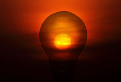 Incandescent  bulb and sunset Stock Photos