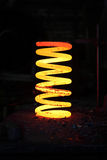 Incandescent iron spring from some heavy wehical Royalty Free Stock Image