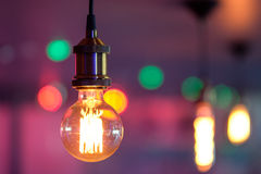 Incandescent lamp compared to other bulbs. During a celebration in the room Stock Photo