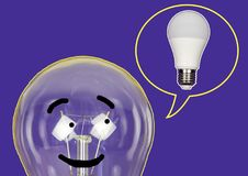 The incandescent lamp dreams of becoming an LED lamp. Stock Photos