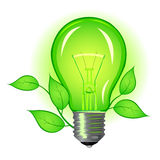 Incandescent lamp with green leaves Stock Photo