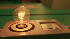 Incandescent light bulb flashes. The Incandescent tungsten light bulb stock video