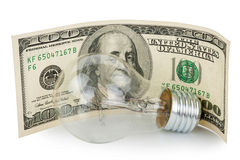 Incandescent light bulb and money Stock Image
