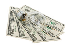 Incandescent light bulb and money Stock Photography