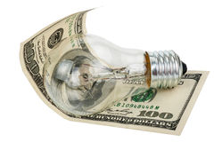 Incandescent light bulb and money Royalty Free Stock Photo