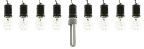 Incandescent light bulbs with energy saving bulb Royalty Free Stock Photography