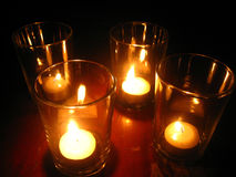 Incandescent. Light a candle in glass several Stock Photos