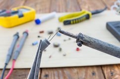 The incandescent soldering-iron and the capacitor. Stock Photo