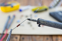 The incandescent soldering-iron and the resistor. Royalty Free Stock Photo