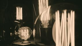 Incandescent tungsten filament trembling in light bulb, creative interior design. Stock footage stock footage