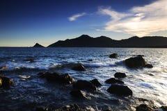 Incandescenza di tramonto al litorale Fotografia Stock Libera da Diritti