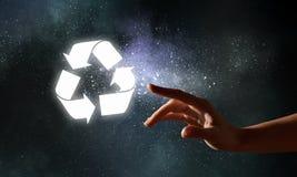 Incandescer recicl o símbolo fotografia de stock royalty free