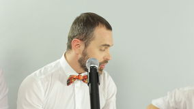 Incendiary singer singing into a microphone on the stock video