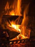 Incendie dans la cheminée Photographie stock