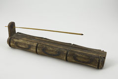 Incense. Burning incense stick on a handcrafted wooden holder Stock Photo