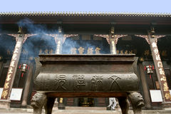 Incense altar in buddhist temple Stock Photo