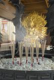 Incense on the altar, praying from the goddess Guan Yin. Stock Photography