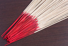 Incense aromatic sticks on the wooden background Stock Image