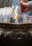 Incense being lit at a Buddhist temple Stock Photography