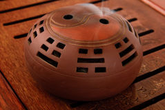 Incense burner  for aromas. On  tea board Royalty Free Stock Photos
