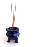 Incense burner. Beautiful Deep Blue Incense burner beside yellow candles Royalty Free Stock Image