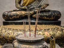 Incense burner with Buddha statue background Stock Photo
