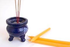 Incense burner beside candles. Beautiful Deep Blue Incense burner beside yellow candles Stock Images
