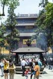 Incense burner at the Chan Buddhist Lingyin Temple. HANGZHOU, CHINA - MAY 4, 2015: Incense burner and people praying at the Lingyin Temple, a Buddhist temple of royalty free stock photography