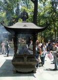 Incense burner at the Chan Buddhist Lingyin Temple. HANGZHOU, CHINA - MAY 4, 2015: Incense burner and people praying at the Lingyin Temple, a Buddhist temple of royalty free stock image