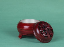 Incense burner. With exquisite carved wooden incense burner Royalty Free Stock Photo