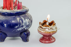 Incense burner  fire  on white background Royalty Free Stock Image