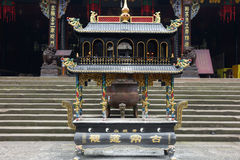 A incense burner in front of temple Royalty Free Stock Images