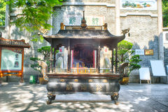Incense burner in front of the temple Royalty Free Stock Photo