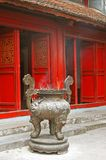 Incense burner outside a buddhist temple. With red doors in Hanoi, Vietnam Royalty Free Stock Images
