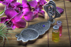 Incense burner with purple orchid Stock Images