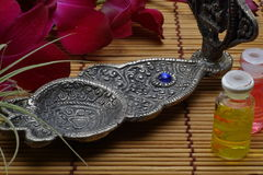 Incense burner with purple orchid Royalty Free Stock Image