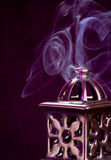 Incense Burner with smoke. Pretty incense burner with smoke coming out of it royalty free stock photos